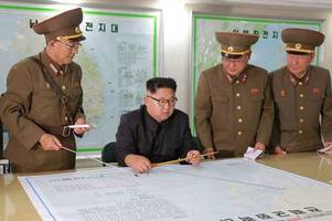 Look inside Kim Jong-un's 'war room': Chubby dictator studies Guam missile strike plan and chilling satellite images