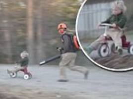 Virginia dad uses leaf blower to push his son's tricycle