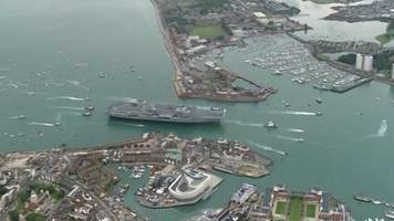 aerial video of hms queen elizabeth arriving in portsmouth
