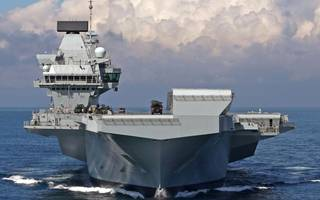 royal navy's largest warship hms queen elizabeth arrives home in portsmouth