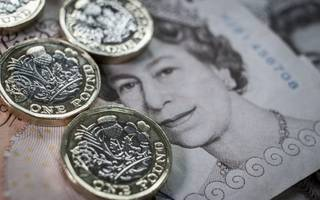 sterling rises as uk wage growth edges up