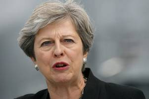 Theresa May finally criticises Donald Trump's white supremacism meltdown - but carefully avoids mentioning him by name