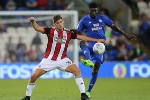 cardiff city fans give ched evans terrific reception as he plays for sheffield united against bluebirds