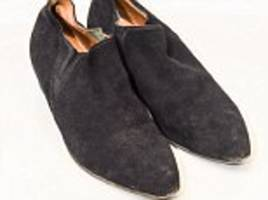 ringo starr's black boots he wore on stage fetch £5,000