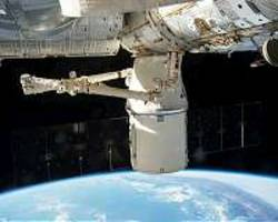 'Dragon captured' as cargo arrives at space station