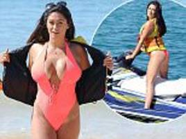 Casey Batchelor rocks a pink swimsuit in Portugal