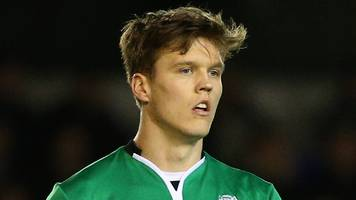 sean raggett: norwich sign lincoln city defender on three-year deal