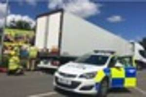 Bungling driver cut free by firefighters after lorry gets stuck...