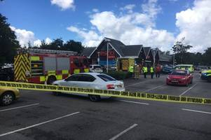 Woman taken to hospital with serious injuries after being trapped under a car in supermarket car park