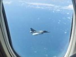 french fighter jets shadow jet2 passenger plane