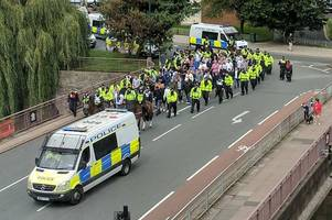 why large groups of police have been pictured surrounding people on bristol streets