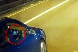 Pictures shows motorist watching a movie while driving on M5 motorway
