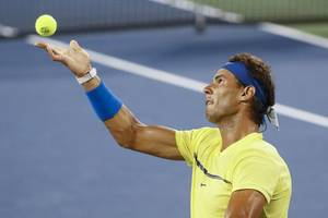 nadal returns to top with heavy heart