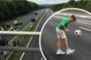 a boy has been spotted playing football on the m20 following a...