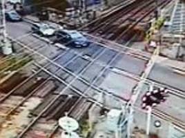 driver gets trapped on level crossing in essex