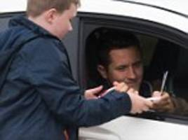 manchester united arrive for training at their aon complex