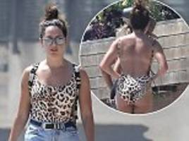 ashley tisdale show off her derriere in leopard costume