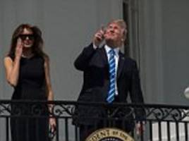 trump watches the eclipse without glasses with melania