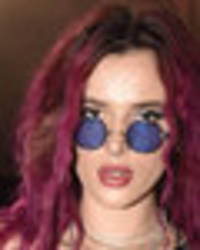 Bella Thorne dons leather chaps and net as she flashes outrageous underboob