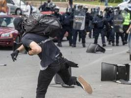 Quebec police hint at arrests following anti-immigration counter-rally turns violent