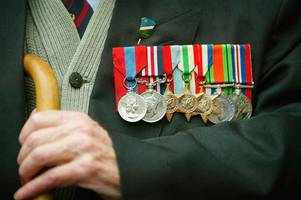 World War Two veteran, 92, robbed 'after being approached by a man asking for change'