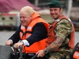 boris johnson takes to anti-pirate boat on trip to nigeria