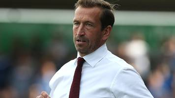 justin edinburgh: northampton town part company with manager