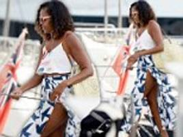 michelle obama shows off her toned legs in a wrap skirt