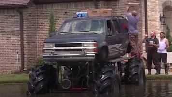 monster trucks beat flooded streets