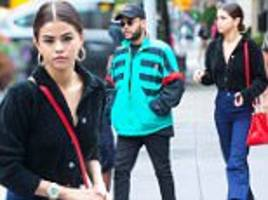 selena gomez heads into a pet store with beau the weeknd