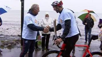 sporting legends carry queen's baton on first leg in wales