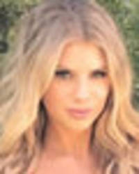 charlotte mckinney flaunts 32f assets in red hot baywatch tribute