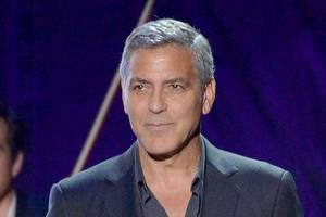 george clooney says he is housing an iraqi refugee attacked by isis