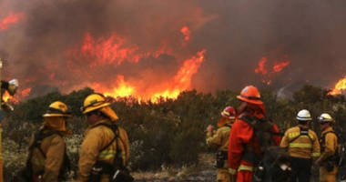 as hurricanes slam the south, shocking images show the western us is literally on fire