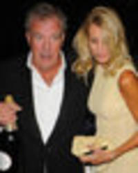 jeremy clarkson makes his first red carpet appearance with new blonde girlfriend