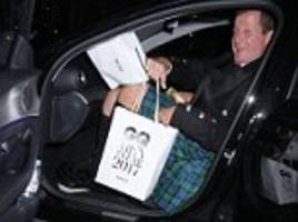 alastair campbell grabs a goodie bag at gq awards