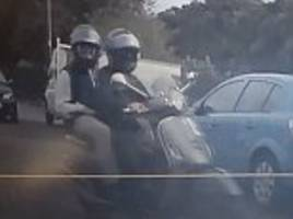 moped chase mum before smashing her car with a hammer