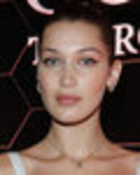 bella hadid flashes knickers as risqué dress turns see-through under flashbulbs