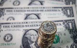 sterling hits one-month high as us dollar falls to fresh 32-month low