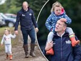 mike tindall gives mia a piggy-back at whatley manor