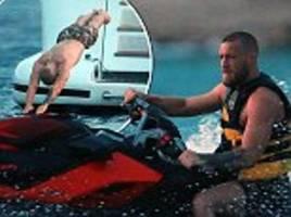 Conor McGregor enjoys jet skiing and partying on boat