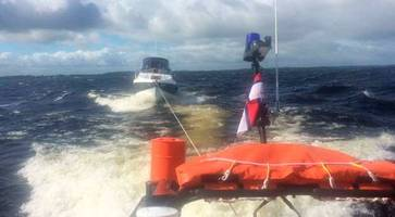 family rescued after lough ree cruiser blown towards rocks in