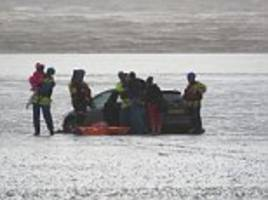 Mother and children rescued after car gets stuck on beach