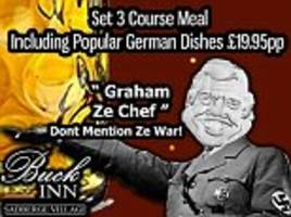 pub advertises 'german night' with a poster of nazi salute