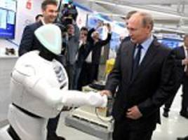 bizarre moment robot interrupts putin to introduce itself