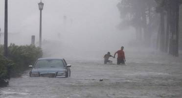 irma death toll climbs to 11 as storm surges flood charleston and savannah
