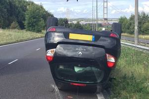 driver overturns car while 'trying to find cash for humber bridge'