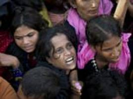 Pictured: Desperate faces of refugees fleeing Myanmar
