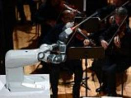 robot conductor yumi steals the show from andrea bocelli
