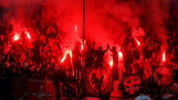 spartak moscow fans appear to throw flare at referee